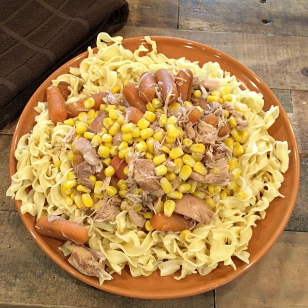 Crockpot Homestyle Shredded Chicken over Noodles